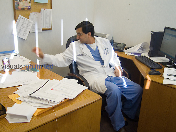 A surgeon working in his office. MR.