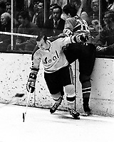 Seals vs Canadiens:Seals Gary Jarrett slams #18 Serge Savard into the boards.  (1970 photo/Ron Riesterer)