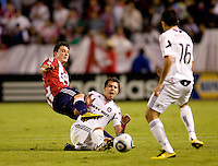 Chivas USA midfielder Ben Zemanski slides into Chicago Fire midfielder Logan Pause both after a loose ball. The Chicago Fire defeated CD Chivas USA 3-1 at Home Depot Center stadium in Carson, California on Saturday October 23, 2010.