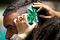 A woman painted marijuana leaf on his head to a man during a demonstration in support for legalization of marijuana in Bogota, May 4, 2013, May 4, 2013. Photo by Freddy Builes / VIEWpress.