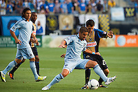 Paulo Nagamura (6) of Sporting Kansas City and Michael Farfan (21) of the Philadelphia Union. Sporting Kansas City defeated the Philadelphia Union 2-0 during the semifinals of the 2012 Lamar Hunt US Open Cup at PPL Park in Chester, PA, on July 11, 2012.