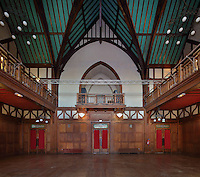 Grand Salon or Great Hall of the central pavilion of the Fondation Deutsch de la Meurthe, with high vaulted ceiling and wood panelling and balconies, designed by Lucien Bechmann, 1880-1968, built 1923-35 and inaugurated in 1925, in the Cite Internationale Universitaire de Paris, in the 14th arrondissement of Paris, France. This was the first residence built at CIUP and was influenced by the style of English University colleges at Oxford and consists of 7 pavilions around a garden. The buildings are listed as a historic monument. The CIUP or Cite U was founded in 1925 after the First World War by Andre Honnorat and Emile Deutsch de la Meurthe to create a place of cooperation and peace amongst students and researchers from around the world. It consists of 5,800 rooms in 40 residences, accepting another 12,000 student residents each year. Picture by Manuel Cohen. Further clearances may be requested.