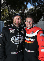Feb. 17, 2013; Pomona, CA, USA; NHRA top fuel dragster driver Clay Millican (right) with Shawn Langdon during the Winternationals at Auto Club Raceway at Pomona. Mandatory Credit: Mark J. Rebilas-