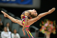 Ekaterina Donich of Russia split leaps with hoop at 2006 Aeon Cup Worldwide Clubs Championships in rhythmic gymnastics on November19, 2006.<br />