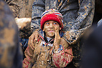 Young boy, covered in mud, held by his father, during the Day of Ashura, on which shi'a muslims commemorate the martyrdom of Husayn ibn Ali, grandson of Muhammad, and third shi'a imam.(Bijar, Iran, 2012).
