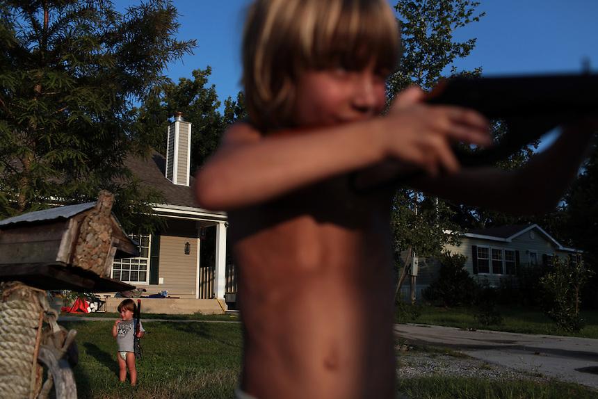 Morgan Serigne, 6, and his brother Joseph Serigne, 1, at their home in Poydras, LA on July 30, 2010.