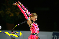 Olga Kapranova of Russia re-catches ribbon during All-Around competition at 2006 Thiais Grand Prix in Paris, France on March 25, 2006.  (Photo by Tom Theobald)<br />