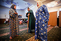 Fatima Davdieva (left) talks with other women in Grozny Central Dome Mosque, the largest mosque in Europe. Fatima, her husband, and their three children fled Grozny ten years ago during the Second Chechen War as refugees. Now as Belgian nationals they return for the first time to visit their friends, family and former home.