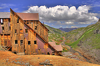 Lewis Mine in Telluride, Colorado is above Bridal Veil Falls in the Bridal Veil basin. The Lewis Mill was built in 1907 and is said to be one of the most intact examples of historic mining sites in the state. Since it is so remote and only accessible by foot (4 miles from the trailhead), most everything has been left alone up there. It is on the National Register of Historic Places. In 2001, the mill was restored by a State Historical Fund grant and the materials used were flown to the site by helicopter. The elevation at the mine is 12,448 feet above sea level.