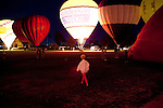A woman walks along glowing hot air balloons following a dinner at the Sun City Country Club in honor of the 50th anniversary of Sun City December 9, 2010...2010 marks the 50th anniversary of Sun City, America's first retirement city that remains the largest today with more than 40,000 residents 55 and older.