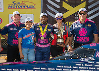 Oct 16, 2016; Ennis, TX, USA; NHRA top fuel driver Antron Brown celebrates with crew after winning the Fall Nationals at Texas Motorplex. Mandatory Credit: Mark J. Rebilas-USA TODAY Sports