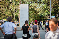 """David Shrigley's """"MEMORIAL"""" 2016 rises in the Doris C. Freedman Plaza of Central Park in New York on Tuesday, September 13, 2016.  The 17-foot tall granite stle sculpture honors the ephemeral shopping list, carved into its permanent granite, celebrating the commonplace. The exhibit will be in place until February 12, 2017. (© Richard B. Levine)"""