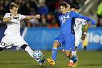 12 December 2014: Providence's Rob Bialy (13) and UCLA's Leo Stolz (GER) (10). The University of California Los Angeles Bruins played the Providence College Friars at WakeMed Stadium in Cary, North Carolina in a 2014 NCAA Division I Men's College Cup semifinal match.