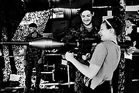 "Switzerland. Canton Fribourg. Estavayer. A young woman is testing a Panzerfaust weapon on a swiss army stall during the Federal Wrestling and Alpine Games Festival. The Panzerfaust 3 (Tank fist 3 or ""The German RPG"") is a modern disposable recoilless anti-tank weapon. 27.08.2016 © 2016 Didier Ruef"