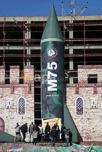 A gigantic model of a locally made M75 rocket is seen on stage during preparations for a Hamas rally in Gaza City on December 6, 2012. Hamas' armed wing said they had fired such a rocket towards Jerusalem and Tel Aviv during the eight day-long conflict between Israel and Hamas last month. Photo by Ashraf Amra
