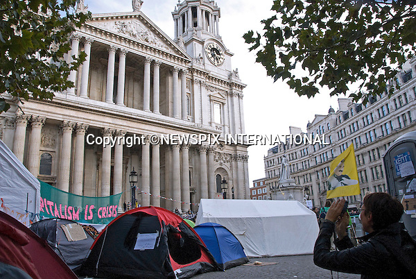 """""""OCCUPY"""" LONDON STOCK EXCHANGE.While St.Paul's Cathedral is closed to the public, the protestors provide a different picture of London for tourists to capture_25/10/2011.Anti-capitalist protesters who set up their tents outside St Paul's Cathedral have forced the cathedral to shut, costing it thousands of pounds a day in lost revenue..Mandatory Credit Photo: ©Dias/NEWSPIX INTERNATIONAL..**ALL FEES PAYABLE TO: """"NEWSPIX INTERNATIONAL""""**..IMMEDIATE CONFIRMATION OF USAGE REQUIRED:.Newspix International, 31 Chinnery Hill, Bishop's Stortford, ENGLAND CM23 3PS.Tel:+441279 324672  ; Fax: +441279656877.Mobile:  07775681153.e-mail: info@newspixinternational.co.uk"""