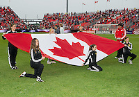 The Canadian flag during the opening ceremonies in an MLS game between Sporting Kansas City and the Toronto FC at BMO Field in Toronto on June 4, 2011..The game ended in a 0-0 draw...