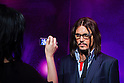 Oct. 4, 2011 - Tokyo, Japan - A Japanese visitor takes a photo of a wax figure of Johnny Depp at the Madame Tussauds museum exhibit. The world's 13th Madame Tussauds museum showcases 19 wax figures of  celebrity musicians and movie stars. (Photo by Christopher Jue/AFLO)