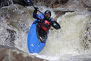 Kayaker going over Lower Falls along the Swift River during the spring months in the White Mountains, New Hampshire USA.