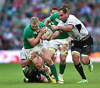 Keith Earls of Ireland takes on the Romania defence. Rugby World Cup Pool D match between Ireland and Romania on September 27, 2015 at Wembley Stadium in London, England. Photo by: Patrick Khachfe / Onside Images