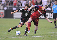 D.C. United forward Josh Wolff (16) goes against Real Salt Lake midfielder Will Johnson (8). D.C. United defeated Real Salt Lake 4-0 at RFK Stadium, Saturday September 24 , 2011.