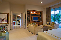 Entertainment center seen in elegant master bedroom