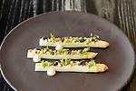 May 8, 2015. Chapel Hill, North Carolina.<br />  The French White Asparagus at [ONE] Restaurant includes mustard, aged shad roe, pinnate and pollen and caviar.<br />  [ONE] Restaurant, located in Chapel Hill's Meadowmont development, specializes in contemporary cuisine, with an emphasis on flavor pairings and unique ingredients. <br />  Outsiders tend to lump Chapel Hill with nearby Durham, but the more sensible pairing is with Carrboro, the adjacent town that was once a mere offshoot known as West End. Even today the transition from Chapel Hill, anchored by North Carolina''s flagship public university, into downtown Carrboro is virtually seamless.