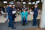 Coast Guard personnel greet a WWII veteran couple for the Veteran's Day observance at Ediz Hook station. She was a Navy nurse for 10 years, including WWII service, and he served in 3 wars including WWII.