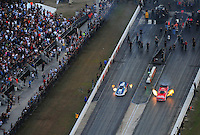 Jan. 21, 2012; Jupiter, FL, USA: Aerial view of NHRA funny car driver Johnny Gray (right) races alongside Tim Wilkerson during testing at the PRO Winter Warmup at Palm Beach International Raceway. Mandatory Credit: Mark J. Rebilas-
