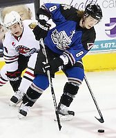 San Antonio Rampage's Tim Kennedy, right, fights for the puck against Rockford Icehogs' Byron Froese during the first period of an AHL hockey game, Saturday, Jan. 14, 2012, in San Antonio. (Darren Abate/pressphotointl.com)