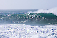 """WAIMEA BAY, Oahu/Hawaii (Tuesday, December 8, 2009) -Greg Long (USA) The Quiksilver In Memory of Eddie Aikau,  was officially  called """"ON"""" by Contest Director George Downing this morning. The ASP specialty sanctioned event kicked off at 8am with wave face heights in the 25-35-foot range..Nine times world champion Kelly Slater (USA) led for most of the day until Greg Long(USA) scored his best four scoring rides in the last heat of the day to over take Slater. Long scored a perfect 100 point wave late in the day to seal the first prize purse of $55,000. Slater was runner up with Sunny Garcia (HAW) in 3rd, defending champion Bruce Irons (HAW) 4th and Ramon Navarro (CHL)  in 5th place. Navarro won the Monster drop award for the biggest drop, also in the final heat of the day when wave faces were pushing 40' plus...The northern hemisphere winter months on the North Shore signal a concentration of surfing activity with some of the best surfers in the world taking advantage of swells originating in the stormy Northern Pacific. Notable North Shore spots include Waimea Bay, Off The Wall, Backdoor, Log Cabins, Rockpiles and Sunset Beach... Ehukai Beach is more  commonly known as Pipeline and is the most notable surfing spot on the North Shore. It is considered a prime spot for competitions due to its close proximity to the beach, giving spectators, judges, and photographers a great view...The North Shore is considered to be one the surfing world's must see locations and every December hosts three competitions, which make up the Triple Crown of Surfing. The three men's competitions are the Reef Hawaiian Pro at Haleiwa, the O'Neill World Cup of Surfing at Sunset Beach, and the Billabong Pipeline Masters. The three women's competitions are the Reef Hawaiian Pro at Haleiwa, the Gidget Pro at Sunset Beach, and the Billabong Pro on the neighboring island of Maui...Photo: Joliphotos.com"""