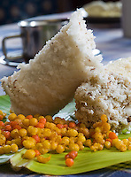 January 27th 2008 _Trivandrum, India _A tasty breakfast meal consisting of either wheat or rice Puttu (in roll), pigeon peas and Pappadom and is unique to India's southern state of Kerala.  Photograph by Daniel J. Groshong/Tayo Photo Group