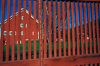 Red barn through fence