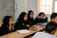 Surman, Libya.  Girls in the Madrasa of Sidi Rashid al-Galili, where they study to memorize the Koran.  Young girls wear the traditional Libyan head scarf.