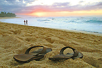 sun sets over sandy beach on Oahu's northshore as this slipper owner opts to go barefoot