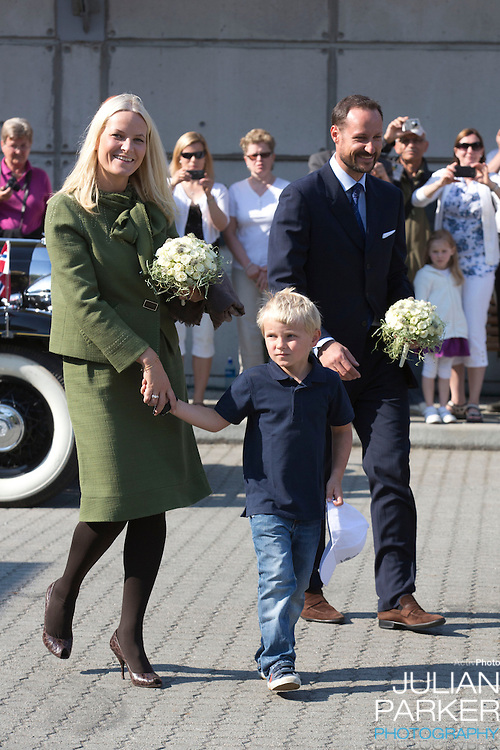 """Crown Prince Haakon, and Crown Princess Mette-Marit of Norway on the first day of their 3 day county trip to More & Romsdal..Visit """" Geiranger """" with their son Prince Sverre Magnus"""