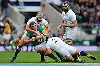 Jack McGrath of Ireland is double-tackled by Joe Marler and Tom Youngs of England. QBE International match between England and Ireland on September 5, 2015 at Twickenham Stadium in London, England. Photo by: Patrick Khachfe / Onside Images