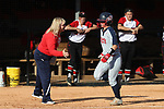 RALEIGH, NC - MARCH 29: Liberty's Emily Sweat (right) is met by head coach Dot Richardson (left) as she rounds third base after hitting a three run home run. The North Carolina State University Wolfpack hosted the Liberty University Flames on March 29, 2017, at Dail Softball Stadium in Raleigh, NC in a Division I College Softball game. Liberty won the game 5-3.