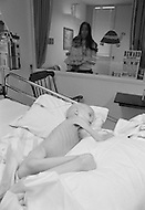 "March 1979, Memphis, Tennessee, USA --- Five-year-old Stacey Haddock from Little Rock, Arkansas fights for her life, looked on by her mother. Stacey is suffering from ""neuroblastoma"" and lost her battle when she died a few days later. Founded by Lebanese actor Danny Thomas, the hospital was the first to cure leukemia in children (Acute Lymphocytic Leukemia) in 1971. --- Image by © JP Laffont/Sygma/Corbis"