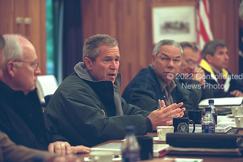 Gathering at Camp David, Maryland, United States President George W. Bush confers with his National Security Council (NSC) Saturday, September 15, 2001. Pictured from left to right are U.S. Vice President Dick Cheney, U.S. Secretary of State Colin Powell, U.S. Secretary of Defense Donald Rumsfeld and Deputy Secretary of Defense Paul Wolfowitz..Mandatory Credit: Eric Draper - White House via CNP.