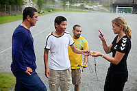 A woman trainer (right) is talking to a few inmates after a run in the yard of the luxurious Halden Fengsel, (prison) after the time they regularly spend carrying out physical exercise and learning about the human body in Halden, near Oslo, Norway.
