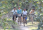 Sum Thida, 12 (second from left), rides home from school in Soepreng, a village in the Kampot region of Cambodia.