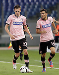 Calcio, Serie A: Lazio vs Palermo. Roma, stadio Olimpico, 2 settembre 2012..Palermo midfielder Josip Ilicic, of Slovenia, in action past teammate Nicolas Bertolo, of Argentina, right, during the Italian Serie A football match between Lazio and Palermo at Rome's Olympic stadium, 2 September 2012..UPDATE IMAGES PRESS/Riccardo De Luca