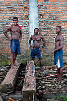 Colombian workers transport timbers from the Pacific rainforest at a sawmill in Tumaco, Colombia, 18 June 2010. Tens of sawmills located on the banks of the Pacific jungle rivers generate almost half of the Colombia's wood production. The wood species processed here (sajo, machare, roble, guabo, cargadero y pacora) are mostly used in the construction industry and the paper production. Although the Pacific lush rainforest in Colombia is one of the most biodiverse area of the world, the region suffers an extensive deforestation due to the uncontrolled logging in the last years.