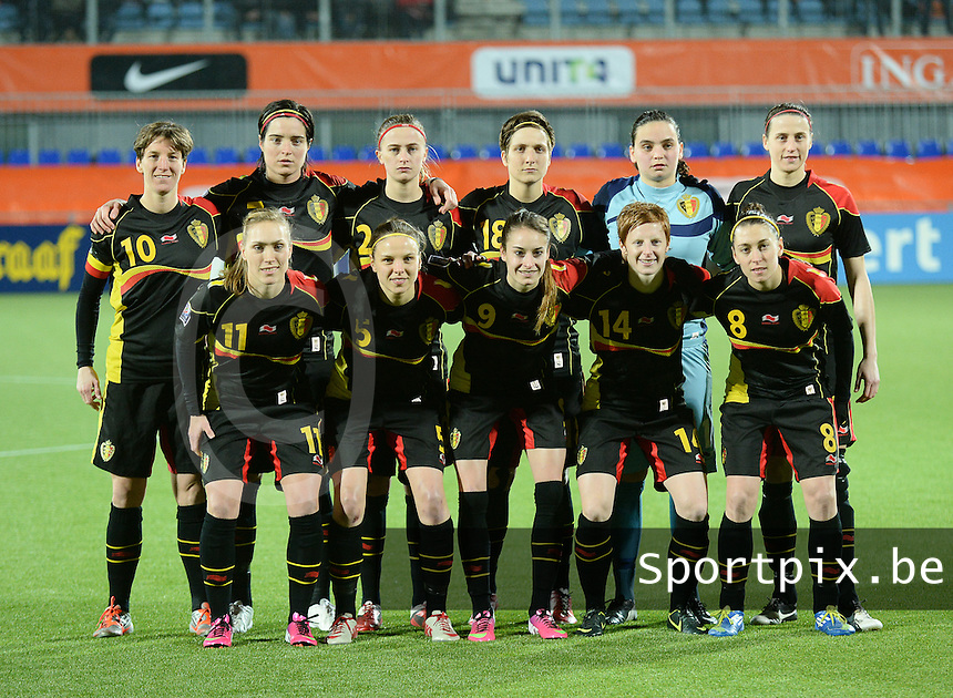20140212 - ZWOLLE , THE NETHERLANDS : Belgian National team pictured with Nicky Evrard (1) , Heleen Jaques (3) , Lorca Van De Putte (5) , Maud Coutereels (18) , Julie Biesmans (20), Lien Mermans (14) , Janice Cayman (11) , Cecile De Gernier (7) , Audrey Demoustier (8) , Aline Zeler (10) and Tessa Wullaert (9) during the female soccer match between The Netherlands and Belgium , on the fifth matchday in group 5 of the UEFA qualifying round to the FIFA Women World Cup in Canada 2015 at Het Ijseldelta Stadion , Zwolle . Wednesday 12th February 2014 . PHOTO DAVID CATRY