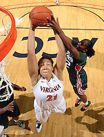 Jan. 6, 2011; Charlottesville, VA, USA; Virginia Cavaliers forward Jazmin Pitts (21) grabs the rebound in front of Miami Hurricanes guard Shenise Johnson (42) during the game at the John Paul Jones Arena. Miami won 82-73. Mandatory Credit: Andrew Shurtleff-