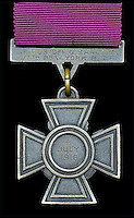 BNPS.co.uk (01202 558833)<br /> Pic: DixNoonanWebb/BNPS<br /> <br /> The reverse of the Victoria Cross showing that Sanders won it on 1 July 1916, the first day of the Battle of the Somme.<br /> <br /> A Victoria Cross awarded to a hero British soldier on the first day of the Somme is being sold by his family for &pound;220,000 over 100 years later.<br /> <br /> Corporal George Sanders led a band of 30 men in repelling repeated German attacks over two days after a communications break down left them cut off in an enemy trench.<br /> <br /> For nearly two days without any food or water, he drove off a raid by the enemy which required hand-to-hand combat using bayonets and then stood firm against two strong bombing attacks.<br /> <br /> His Victoria Cross and Military Cross have been passed down through the family and are now to be sold for the very first time at London auctioneers Dix Noonan Webb.