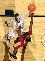 Dec. 30, 2010; Charlottesville, VA, USA; Virginia Cavaliers forward Will Regan (4) shoots over Iowa State Cyclones forward Calvin Godfrey (15) during the game at the John Paul Jones Arena. Iowa State Cyclones won 60-47. Mandatory Credit: Andrew Shurtleff