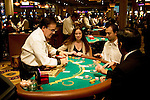 Blackjack table in Las Vegas, Nevada, Caesars Palace and Casino, gaming, gambling, chips, blackjack, betting croupier, blackjack players, model released, blackjack table, cards, NV, Las Vegas, Photo nv242-17429. .Copyright: Lee Foster, www.fostertravel.com, 510-549-2202,lee@fostertravel.com