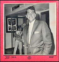 BNPS.co.uk (01202 558833)<br /> Pic: DominicWinter/BNPS<br /> <br /> The 'King of Cool' Dean Martin.<br /> <br /> A remarkable set of 430 candid photographs of Hollywood royalty have been unearthed after 50 years.<br /> <br /> Included in the collection of unpublished pictures are snaps of silver screen icons Paul Newman, Charlie Chaplin, Bette Davis, Audrey Hepburn, and Dean Martin.<br /> <br /> Paul Newman is captured looking over his shoulder at the wheel of his car and Charlie Chaplin is pictured without his trademark moustache. <br /> <br /> Audrey Hepburn has posed with her then husband actor Mel Ferrer while Bette Davis can be seen puffing on a cigarette.<br /> <br /> The snaps were taken by obsessive amateur photographer Dwight 'Dodo' Romero from 1954 to 1967 who would hang around at Hollywood parking lots and other hang-outs to catch a glimpse of the stars.<br /> <br /> The photos, which more recently belonged to a book dealership in York, have emerged for auction and are tipped to sell for &pound;800.